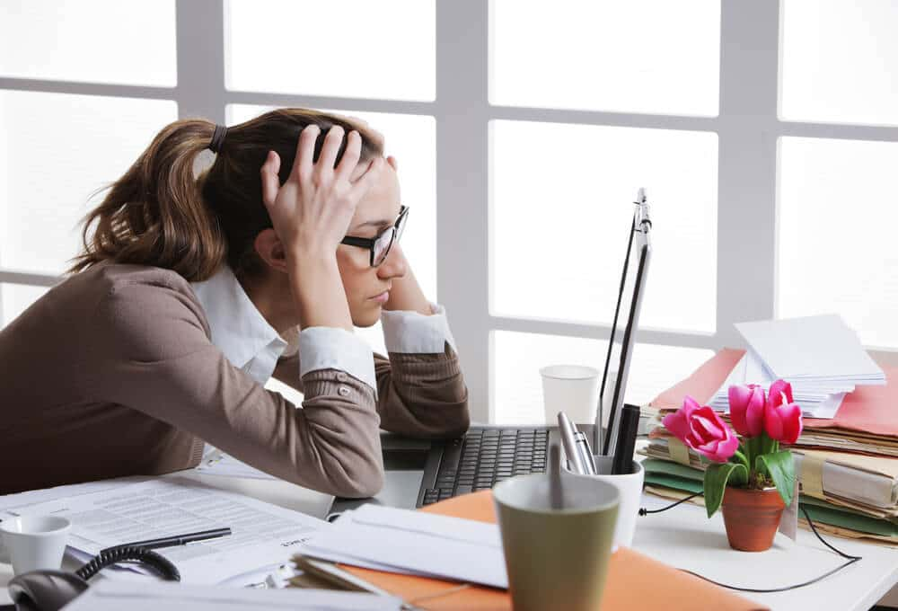 business owner carrying out a bank reconciliation